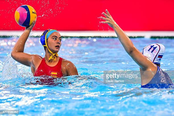 Mireia Guiral of Spain takes a shot at goal under pressure from Bella Khamzaeva of Russia in the Women's Waterpolo Final during day eight of the Baku...