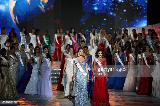 Mireia Lalaguna Royo of Spain and Thilini Amarasooriya of Sri Lanka perform onstage during the Miss World Grand Final on December 19 2015 in Sanya...