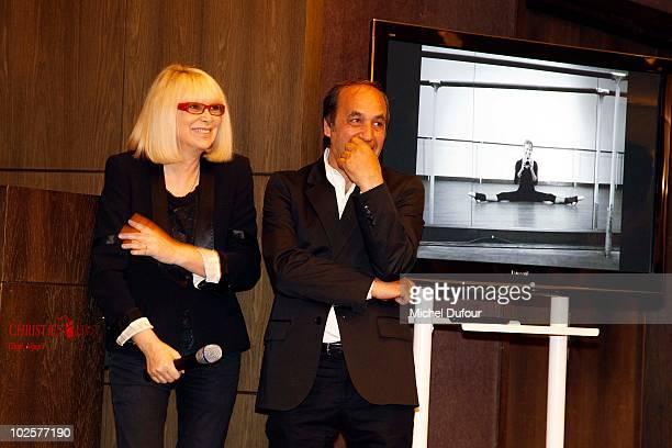 Mireille Darc and phographer Richard Melloul attend the auction at Christie's for Association Chaine de l'Espoir on July 1 2010 in Paris France