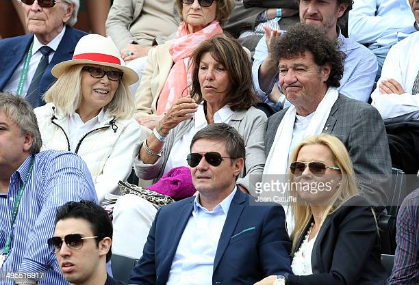 Mireille Darc Laurence Charlebois and husband Robert Charlebois attend Day 10 of the French Open 2014 held at RolandGarros stadium on June 3 2014 in...