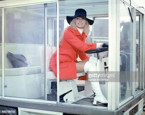 Mireille Darc on the set of Elle boit pas, elle fume pas, elle drague pas mais... Elle cause directed by Michel Audiard/ Film Gaumont