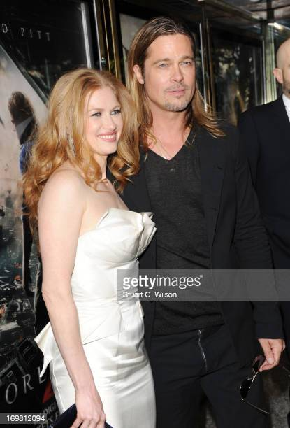 Mireille Enos and Brad Pitt attend the World Premiere of 'World War Z' at The Empire Cinema on June 2, 2013 in London, England.