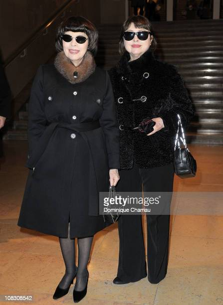 Mireille Mathieu and guest pose as they arrive at the Stephane Rolland show as part of the Paris Haute Couture Fashion Week Spring/Summer 2011 at...