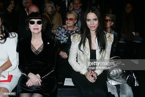 Mireille Mathieu and Melissa Mars attend the Stephane Rolland Fashion Show during Paris Fashion Week Haute Couture SpringSummer 2011 at the Palais de...