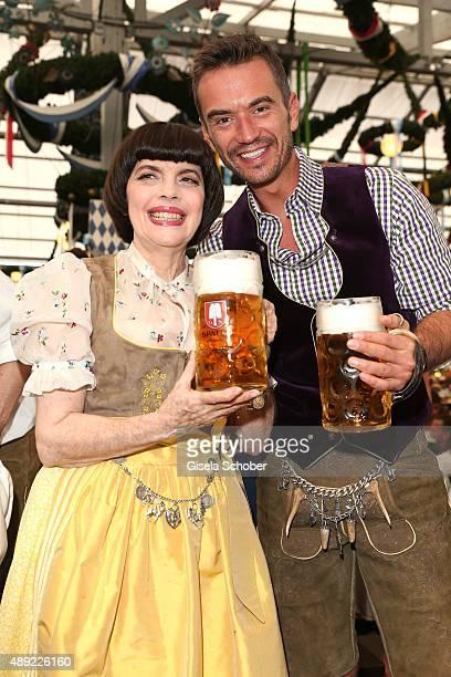 Mireille Mathieu wearing a dirndl by Daniel Fendler and Florian Silbereisen during the Oktoberfest 2015 Opening at Schottenhamel beer tent at...