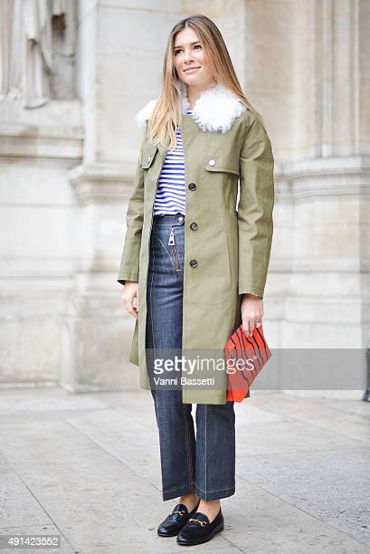 Mirela Foric Srna poses wearing Louis Vuitton coat and pants Gucci loafers and Loewe clutch before the Stella McCartney show at the Opera Garnier...