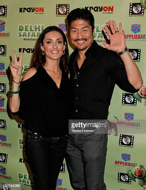 Mirelly Taylor and Brian Tee attends the Delhi Safari Los Angeles premiere at Pacific Theatre at The Grove on December 3 2012 in Los Angeles...