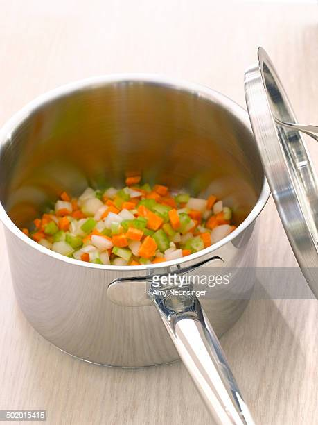 Mirepoix of carrots, celery and onion in saucepan.