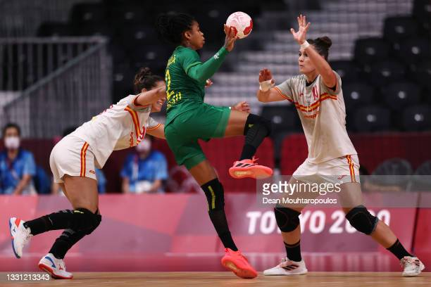 Mireya Gonzalez Alvarez and Elisabet Cesareo Romero of Team Spain stop the shot on goal from Bruna de Paula of Team Brazil during the Women's...