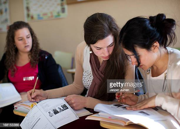 Miriam Alonso 28 yearsold from Palencia works with Wendy Paniagua 29 yearsold from Granada during their daily Dutch language class preparing them for...