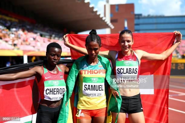 Miriam Cherop of Kenya Alemaz Samuel of Ethiopia and Delia Sclabas of Switzerland celebrate celebrate winning medals in the final of the women's...