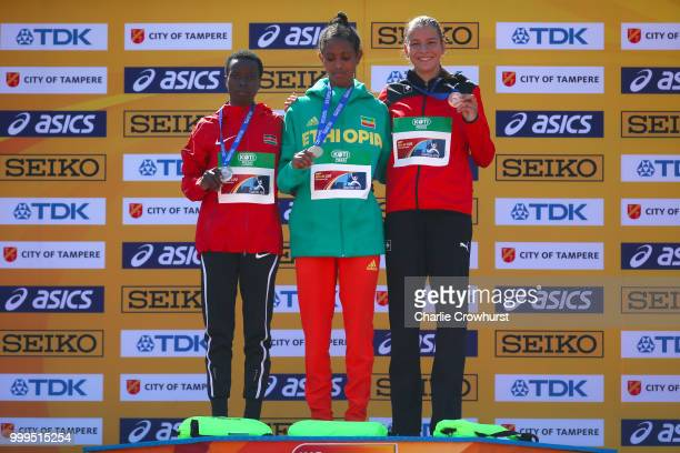 Miriam Cherop of Kenya Alemaz Samuel of Ethiopia and Delia Sclabas of Switzerland celebrate with their medals during the medal ceremony for the...