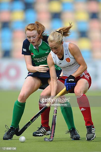 Miriam Crowley of Ireland and Natalie Seymour of England battle for the ball during the Women´s EuroHockey Championships 2011 Pool B match between...