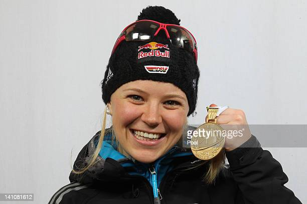 Miriam Goessner of Germany shows her medal of the Women's 4 x 6km Relay during the IBU Biathlon World Championships at Chiemgau Arena on March 10,...