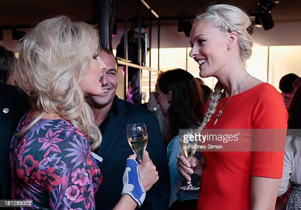 Miriam Hoeller and guest attend the Laurel Flagship Store Opening on September 19 2013 in Munich Germany