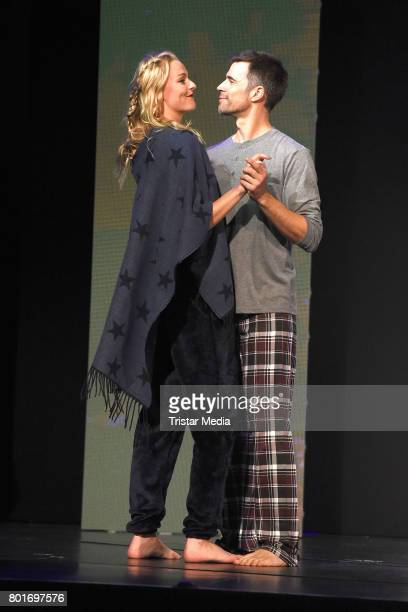 Miriam Hoeller and Jo Weil walk the runway during the Ernsting's Family Fashion Show at Stage Operettenhaus on June 26 2017 in Hamburg Germany