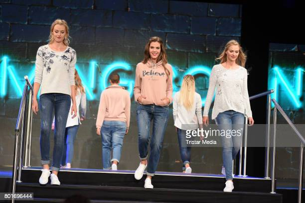 Miriam Hoeller and models walk the runway during the Ernsting's Family Fashion Show at Stage Operettenhaus on June 26 2017 in Hamburg Germany