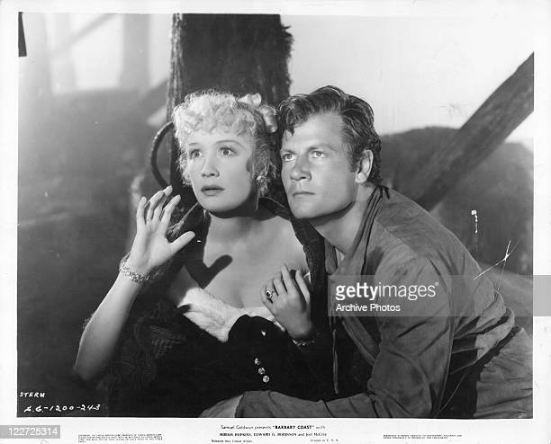 Miriam Hopkins and Joel McCrea huddled together in a scene from the film 'Barbary Coast' 1935