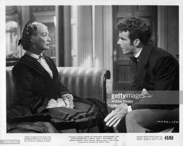 Miriam Hopkins and Montgomery Clift have conversation while sitting down in a scene from the film 'The Heiress' 1949