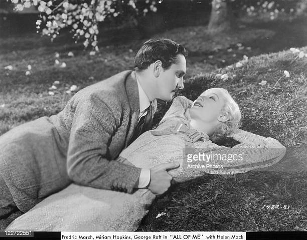 Miriam Hopkins is laying on the Grass as Fredric Marc has his hand on her waist in a scene from the film 'All Of Me' 1934