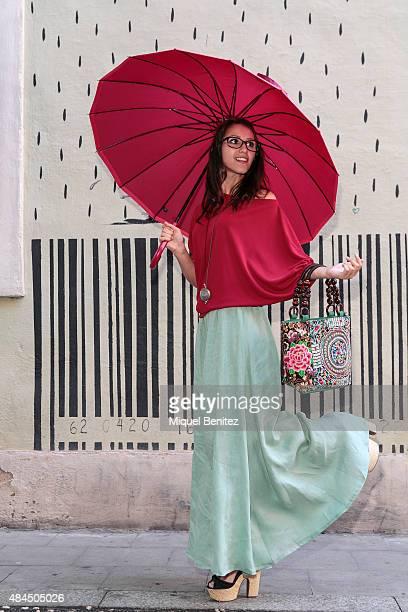 Miriam is wearing a Jose Rivero blouse and skirt Coral Rivero jewelry Klu handbag Bisetti umbrellas Tous eyeglasses and Mari Paz shoes on August 19...