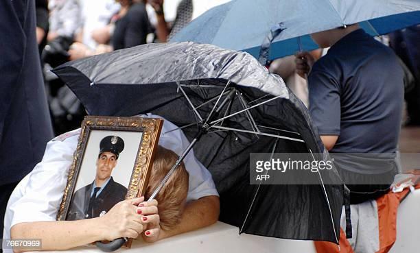 Miriam Jurabe of the Bronx who lost her son Angel Jurabe Jr of Ladder 12 in the 11 September 2001 terrorist attacks on the World Trade Center holds...