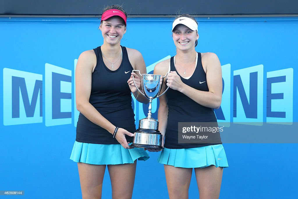Miriam Kolodziejova of the Czech Republic and Marketa Vondrousova of the Czech Republic hold the winners tropy after winning their final doubles match against Katharina Hobgarski of Germany and Greet Minnen of Belgium during the Australian Open 2015 Junior Championships at Melbourne Park on January 30, 2015 in Melbourne, Australia.