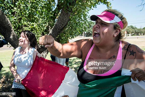Miriam Ledezma right protests in front of the Laredo Airport as Republican Presidential candidate and business mogul Donald Trump visits during his...