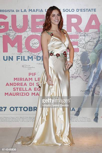 Miriam Leone walks a red carpet for 'In Guerra Per Amore' on October 12, 2016 in Rome, Italy.
