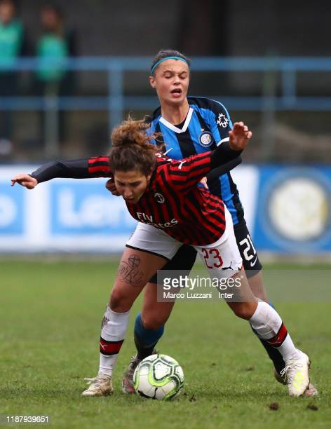 Miriam Longo of AC Milan competes for the ball with Caterina Fracaros of FC Internazionale during the Women Coppa Italia match between FC...