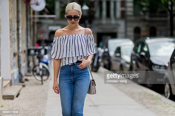 Miriam Mache wearing a white navy striped off shoulder shirt from Zara a Radley London bag blue BDG denim jeans Rodenstock sunglasses on May 29 2016...