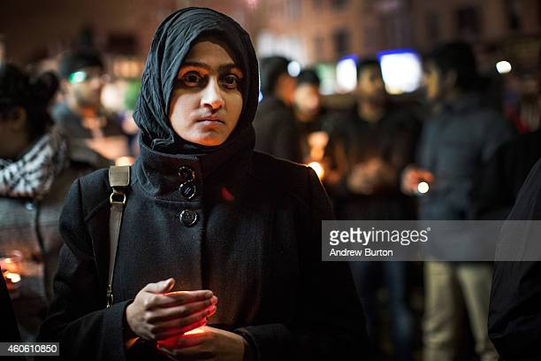 Miriam Mahood attends a candlelight vigil for the 132 students killed in a terror attack yesterday in Pakistan on December 17 2014 in the Midwood...