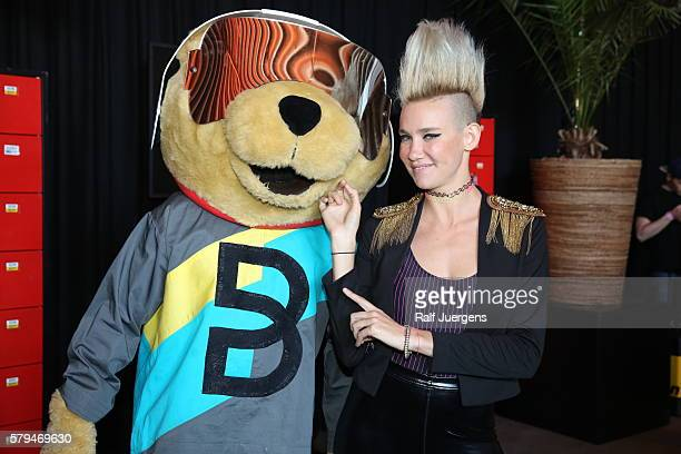 Miriam Nervo and BreuniBaer mascot of Breuninger pose for a photograph at the ParookaVille Festival on July 15 2016 in Weeze Germany