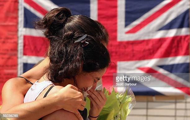 Miriam Rasekh is consoled by a friend as she weeps for her lost aunt after standing for a twominute silence one week after the London terrorist...