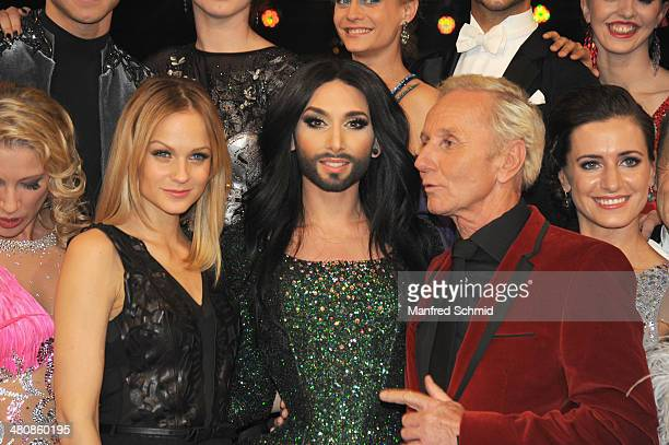 Miriam Weichselbraun Conchita Wurst and Klaus Eberhartinger pose for a photograph during the 'Dancing Stars' TV Show after party at ORF Zentrum on...