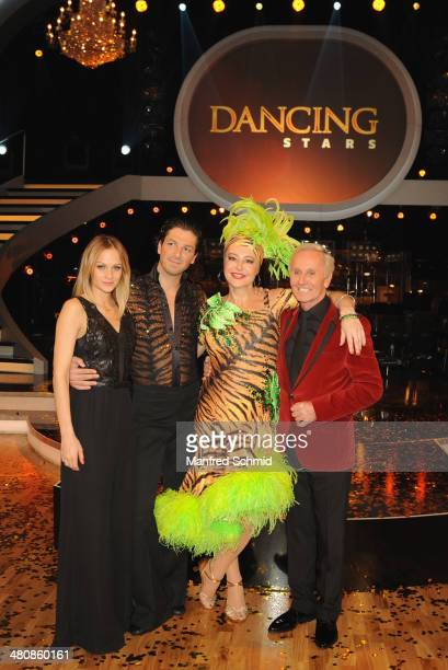 Miriam Weichselbraun Thomas Kraml Andrea Buday and Klaus Eberhartinger pose for a photograph during the 'Dancing Stars' TV Show after party at ORF...