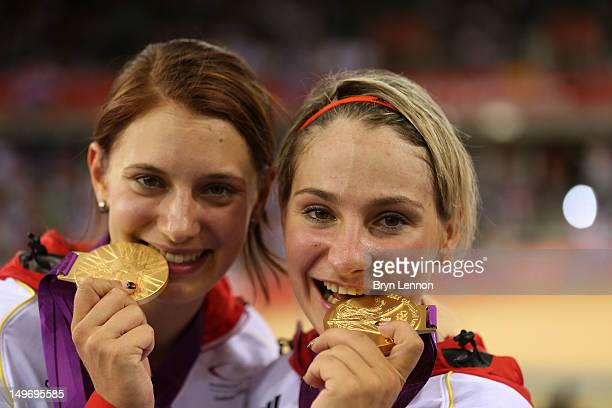 Miriam Welte and Kristina Vogel of Germany pose with their gold medals during the medal ceremony for the Women's Team Sprint Track Cycling on Day 6...