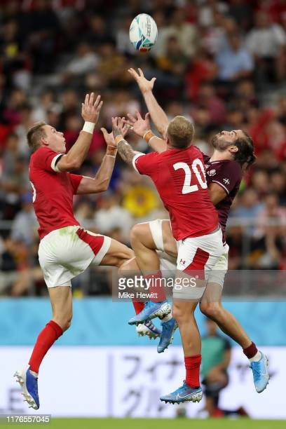 Miriani Modebadze of Georgia competes for a high ball with Liam Williams and Ken Owens of Wales during the Rugby World Cup 2019 Group D game between...