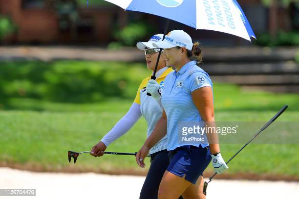 Mirim Lee and Amy Yang both of Republic of Korea walk to the 2nd green during round three of the Dow Great Lakes Bay Invitational at Midland Country...