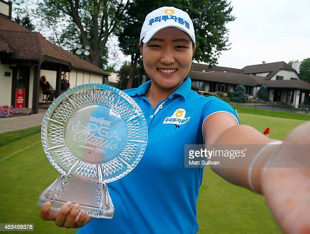 Mirim Lee of South Korea imitates a 'selfie' after winning the Meijer LPGA Classic at Blythefield Country Club on August 10 2014 in Belmont Michigan