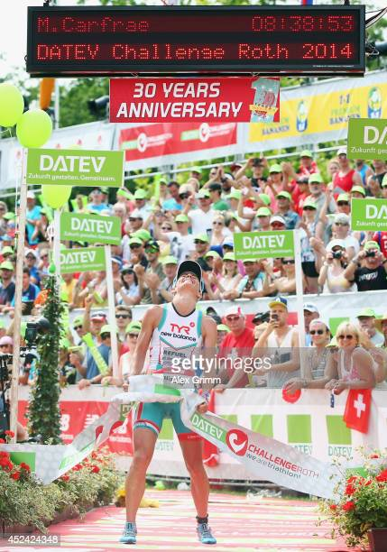 Mirinda Carfrae of Australia celebrates winning the Challenge Roth on July 20 2014 in Roth Germany
