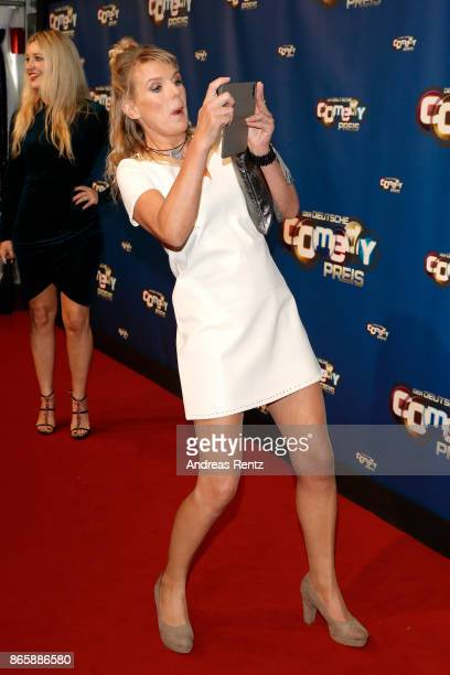 Mirja Boes takes a picture as she attends the 21st Annual German Comedy Awards at Studio in Koeln Muehlheim on October 24 2017 in Cologne Germany