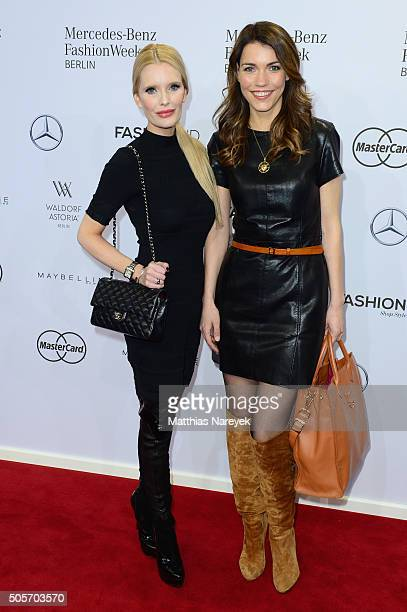 Mirja du Mont and Annett Moeller attend the Riani show during the MercedesBenz Fashion Week Berlin Autumn/Winter 2016 at Brandenburg Gate on January...
