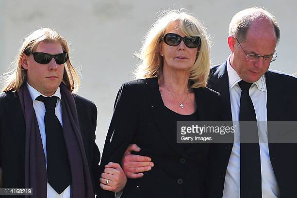 Mirja Larson wife of defunct Gunter Sachs sons Halifax Sachs Christian Sachs attend Gunter Sachs' funeral service held at Mauritiuskirche on May 13...