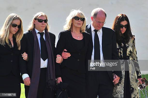 Mirja Larson wife of Gunter Sachs sons Halifax Sachs Christian Sachs and mourners attend Gunter Sachs' funeral service held at Mauritiuskirche on May...