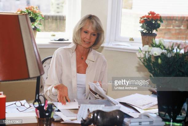 Mirja the wife of Gunter Sachs at the desk sorting papers 2000s