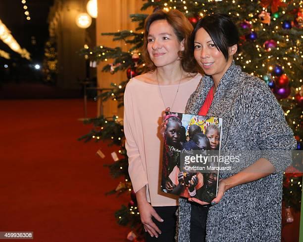 Mirjam Knickriem and MinhKhai PhanThi attend the 'Mein Mali' Book Presentation at Komische Oper on December 4 2014 in Berlin Photo by Christian...