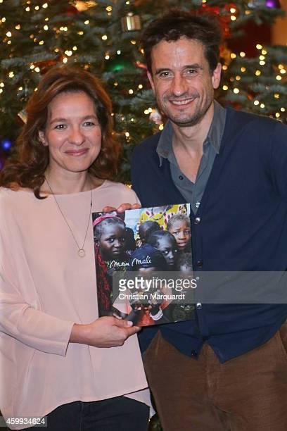 Mirjam Knickriem and Oliver Mommsen attend the 'Mein Mali' Book Presentation at Komische Oper on December 4 2014 in Berlin
