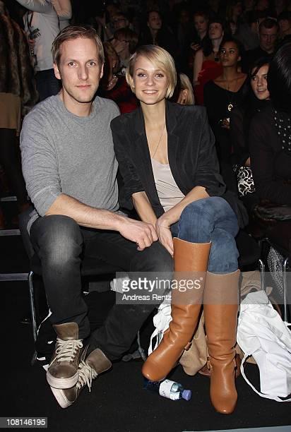 Mirjam Weichselbraun and boyfriend Jan Hahn sit in front row at the Dimitri Show during the Mercedes Benz Fashion Week Autumn/Winter 2011 at...
