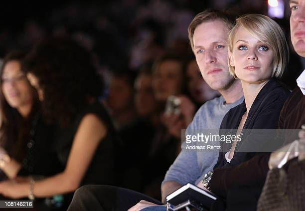 Mirjam Weichselbraun and boyfriend Jan Hahn sit in front row at the Dimitri Show during the Mercedes Benz Fashion Week Autumn/Winter 2011 at...